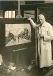 1089-051 W.L Bouwmeester in zijn atelier bij een schilderij van stoomtreinen