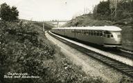 3497 Oosterbeek. Talud met dieseltrein, 1930-1940